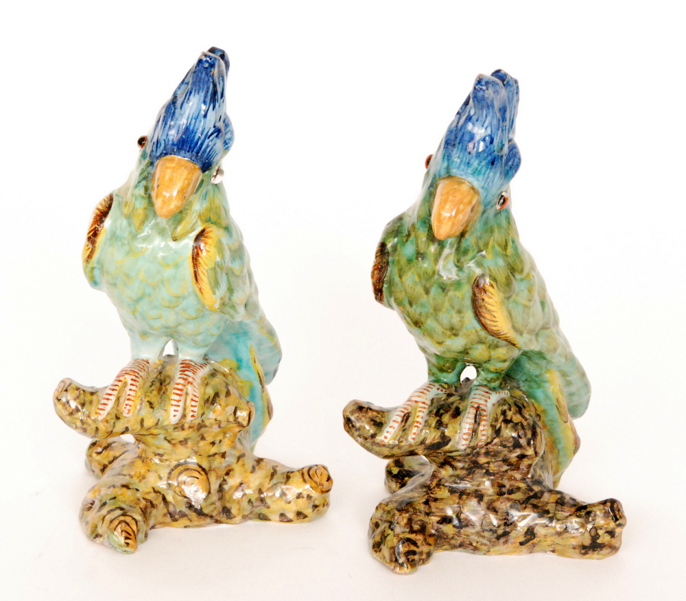 Lot 16 - Two continental model parrots each glazed in green with blue feathered plumes,