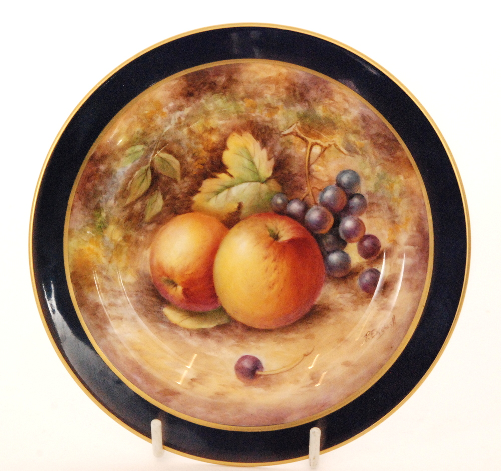 Lot 51 - A small Royal Worcester Fallen Fruits cabinet plate decorated by P.
