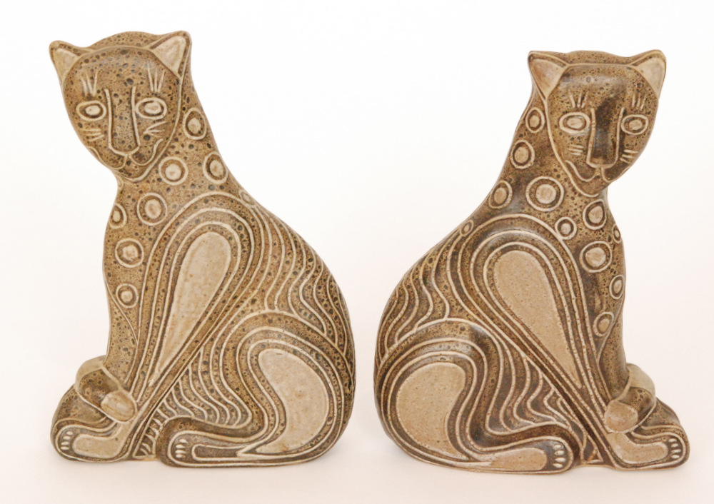 Lot 7 - A pair of later 20th Century studio pottery models of seated leopards,
