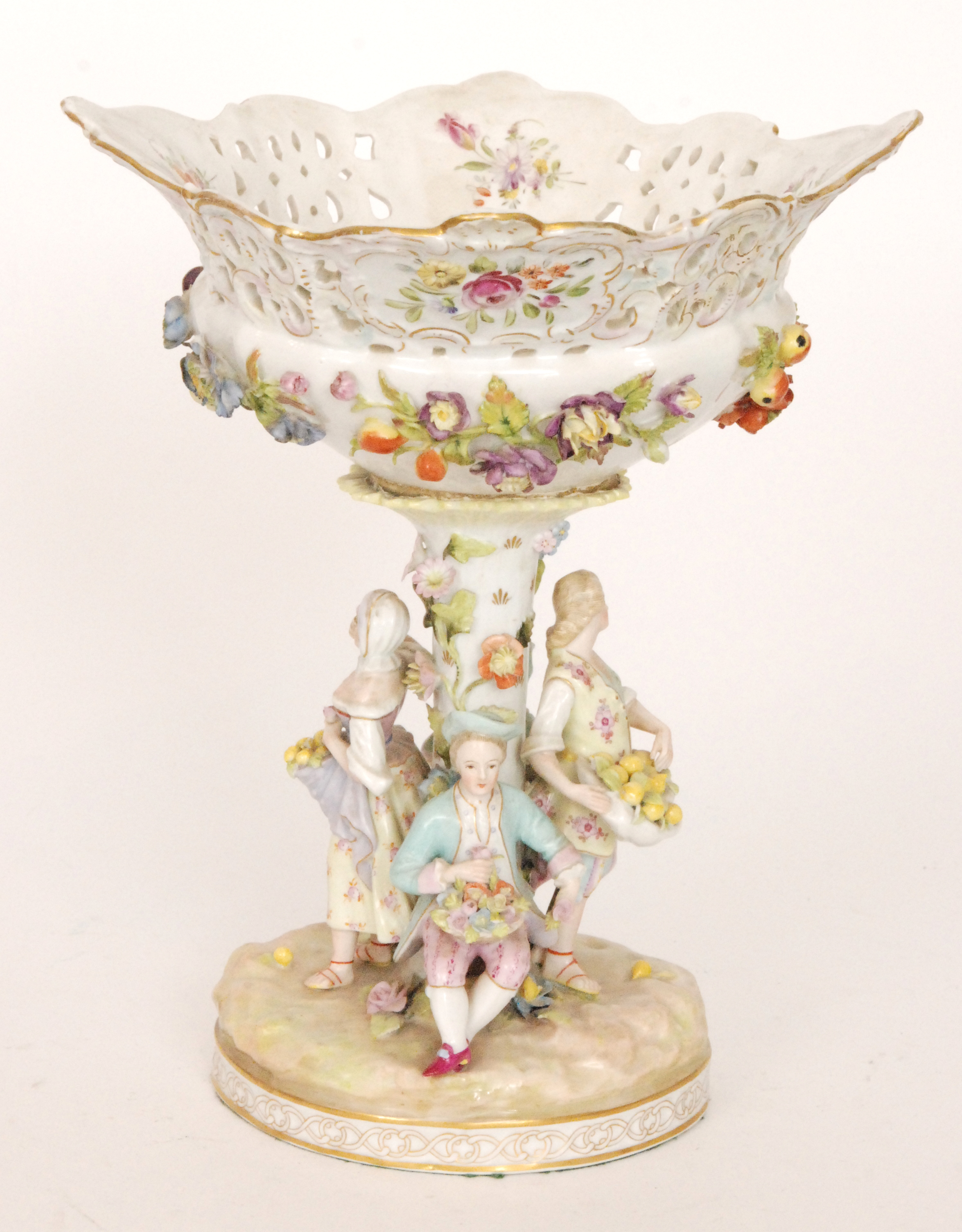 Lot 45 - An early 20th Century floral encrusted pedestal fruit basket with figures stood around the central