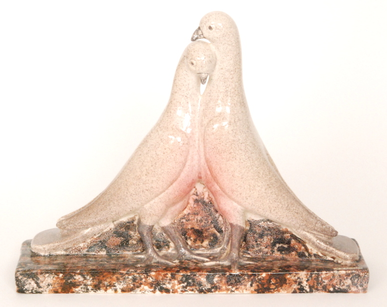 Lot 23 - A studio pottery model of two doves stood on a rectangular plinth,