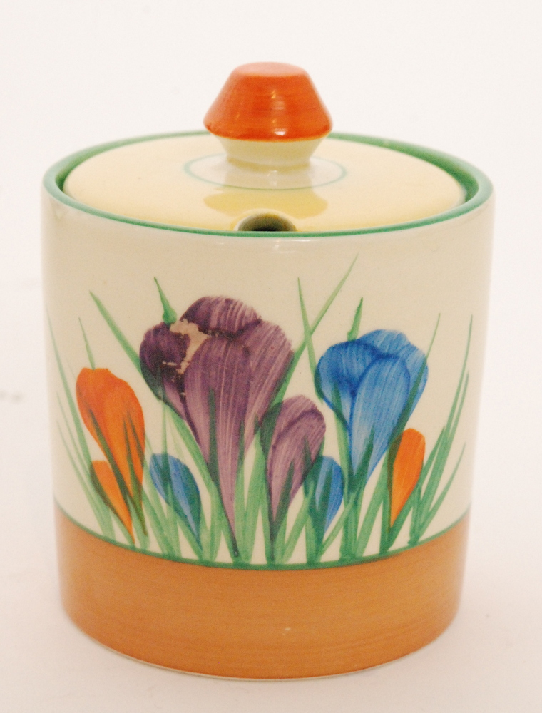 Lot 49 - A Clarice Cliff Crocus pattern cylindrical drum preserve pot circa 1950 hand painted with crocus