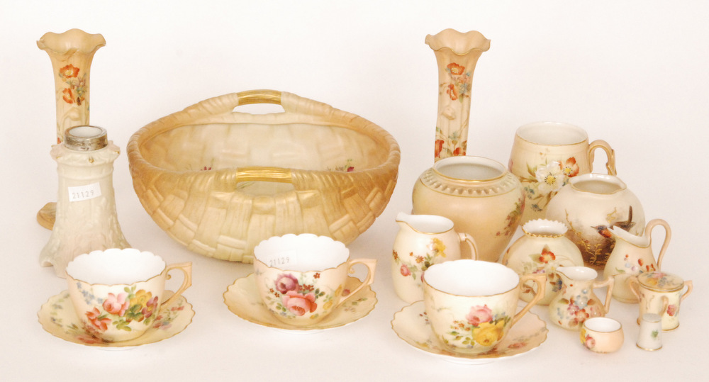 Lot 59 - A small collection of assorted Royal Worcester blush ivory to include two teacups and saucers and a