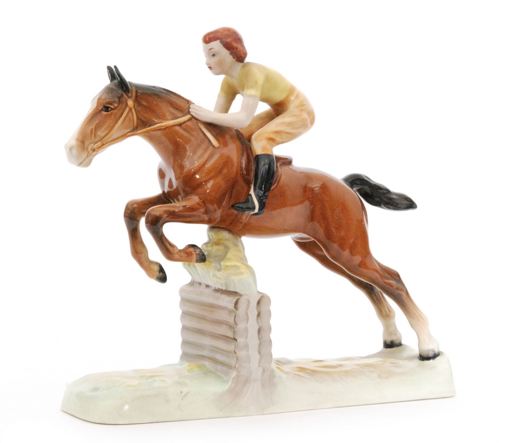 Lot 29 - A Beswick Pottery figure of a Girl on a Jumping Horse, model 939, circle mark, height 25cm.