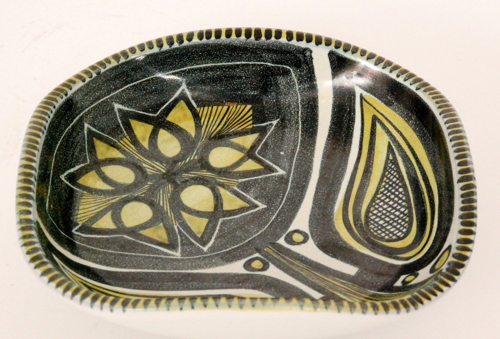 Lot 20 - A post war Danish studio pottery bowl of rounded square form decorated with a hand painted stylised