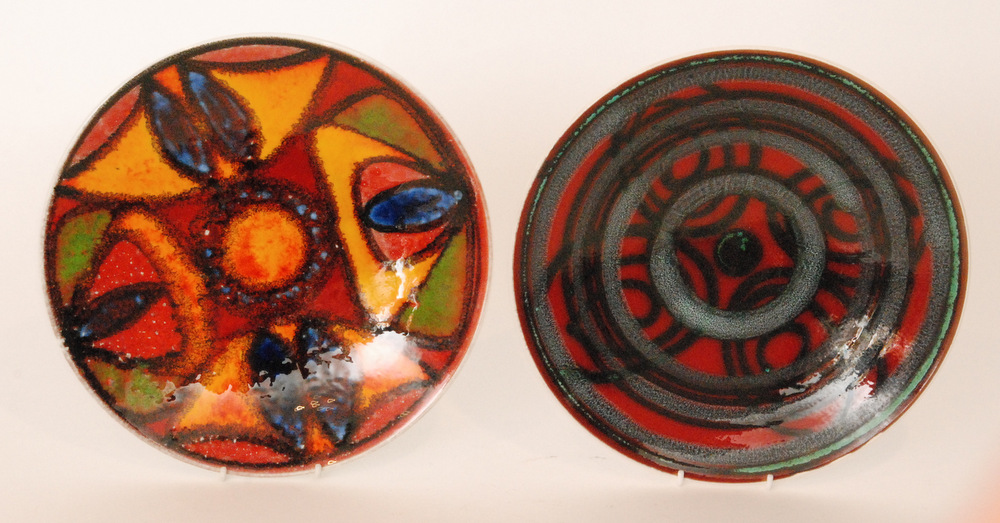Lot 55 - Two Poole Pottery Delphis shape 4 chargers,
