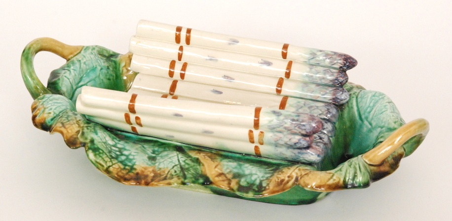 Lot 17 - A late 19th to early 20th Century majolica asparagus dish,