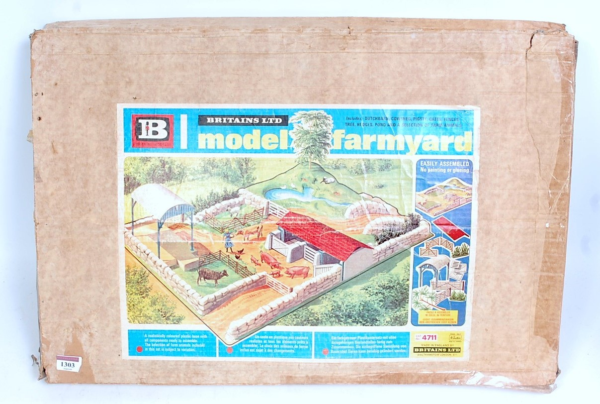 A Britains No. 4711 Britains model farm yard play set comprising of plastic play base with various