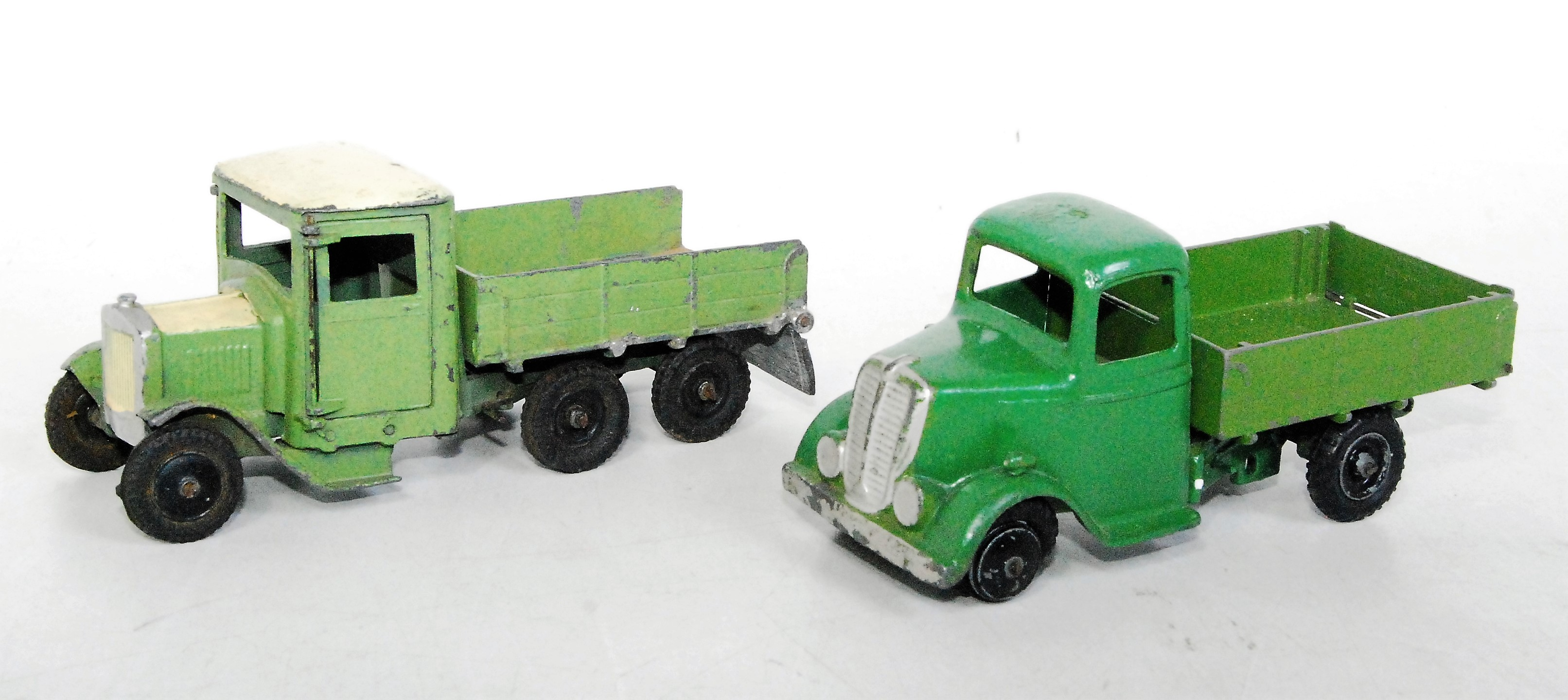 A Britains repainted and partly restored tipper group to include a Britains No. 60F six wheel tipper