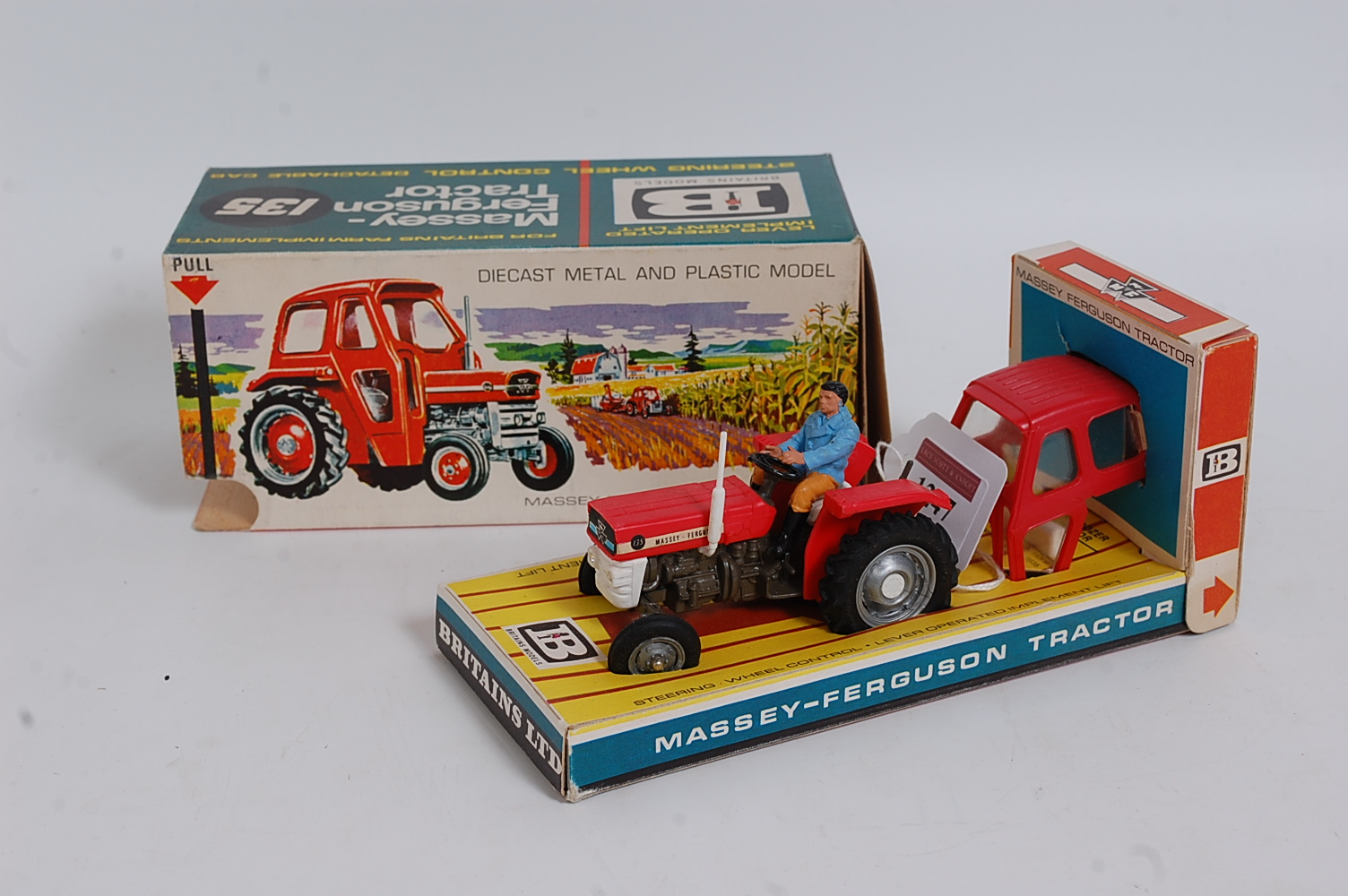A Britains No. 9529 Massey Ferguson 135 tractor, comprising of grey, red and white body with