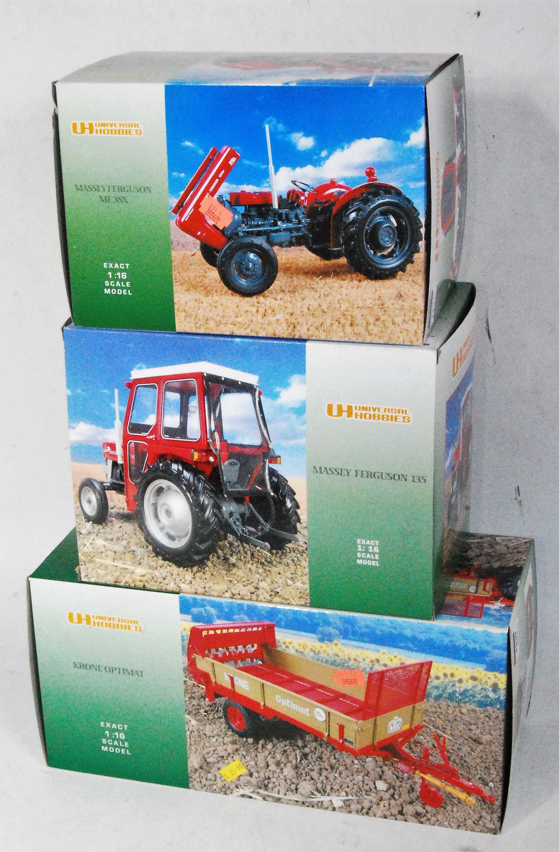 Three various boxed as issued Universal Hobbies 1/16 scale model tractors and tractor implements