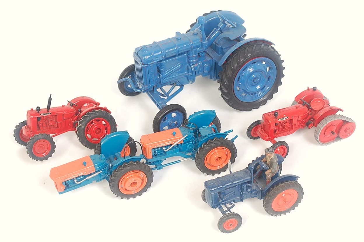 Five various diecast white metal and resin manufactured and kit built tractor models to include a