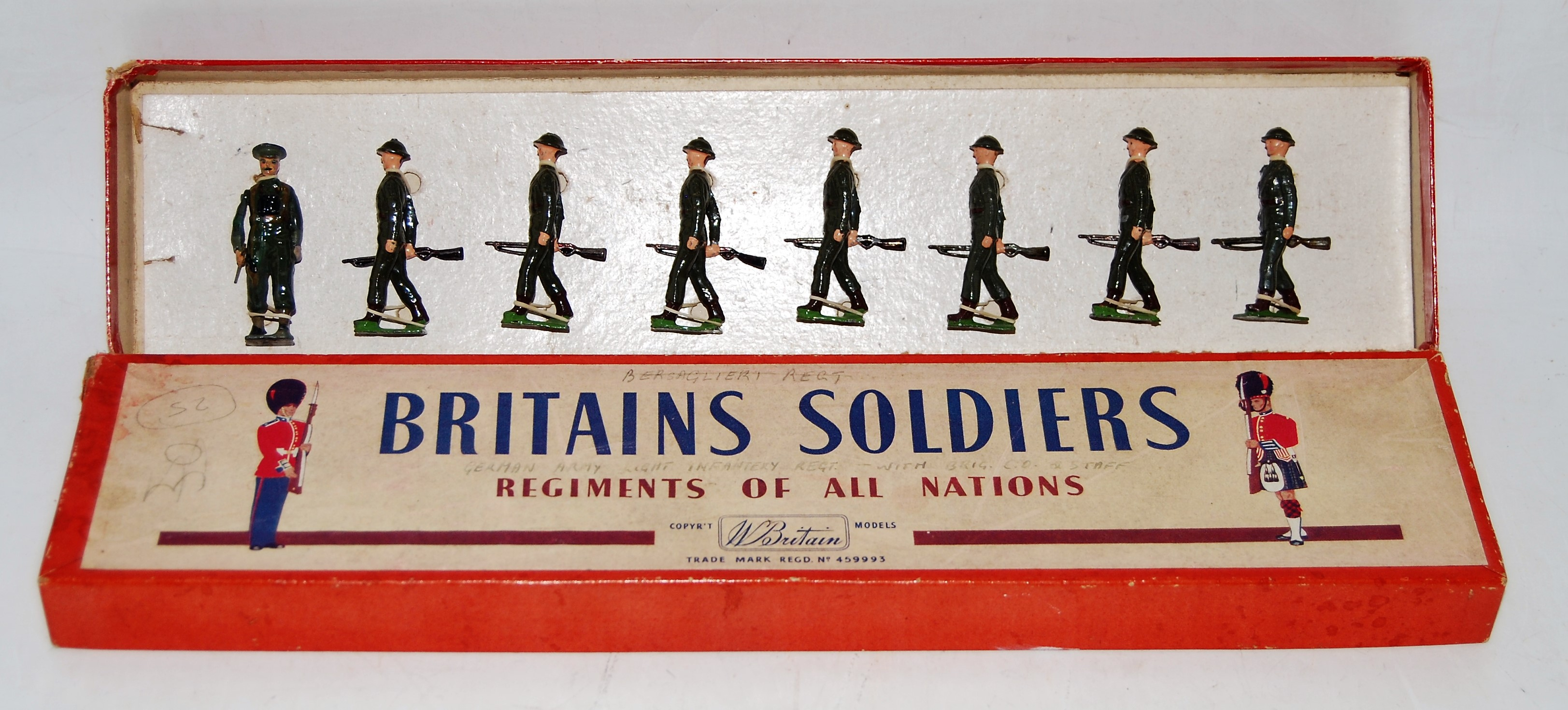 A Britains set No. 1858 British Infantry in full battle dress, comprising of marching officer with