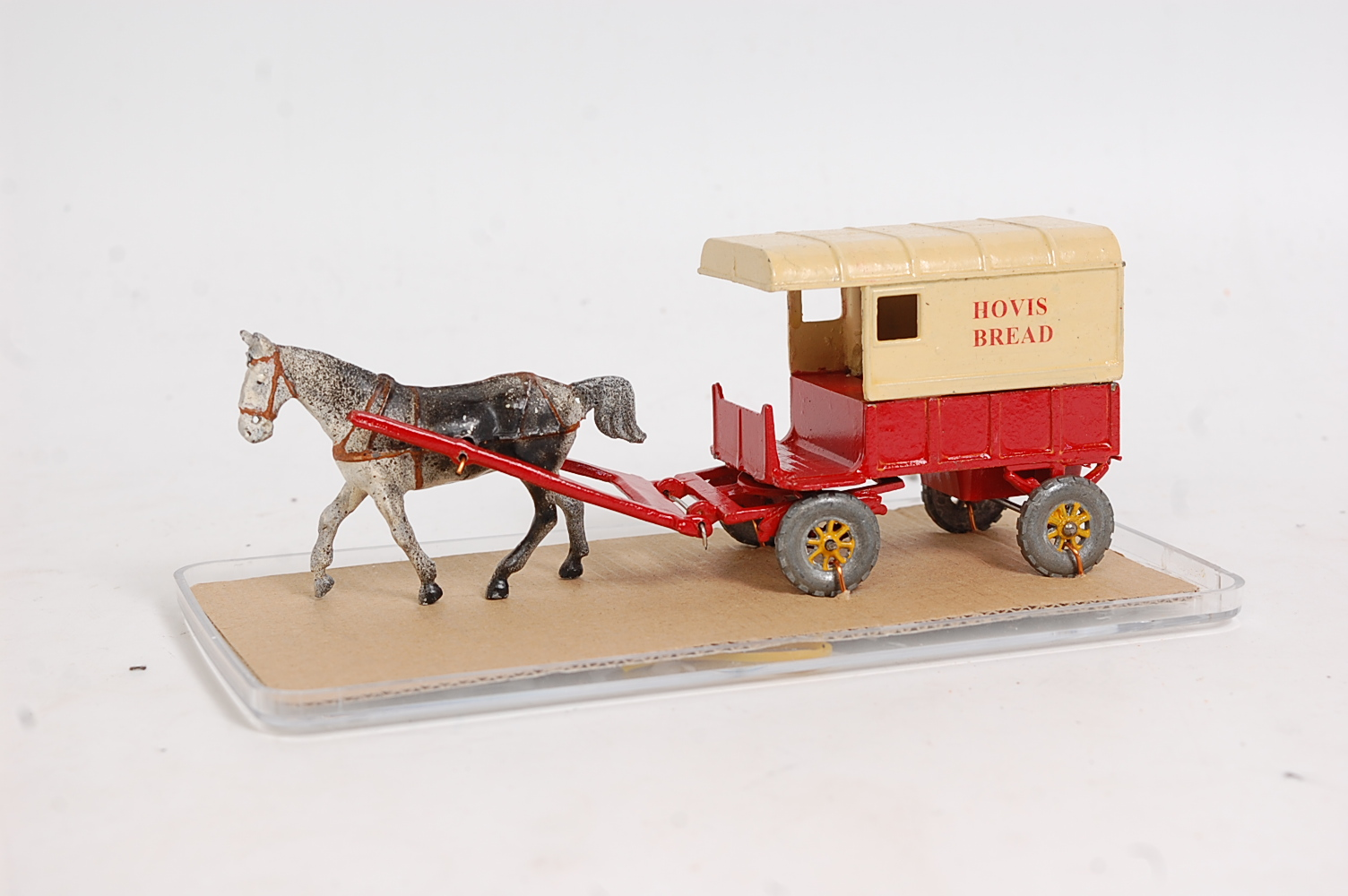 A Charbens 1950s repainted model of a lead horsedrawn Hovis Bread delivery cart, comprising red