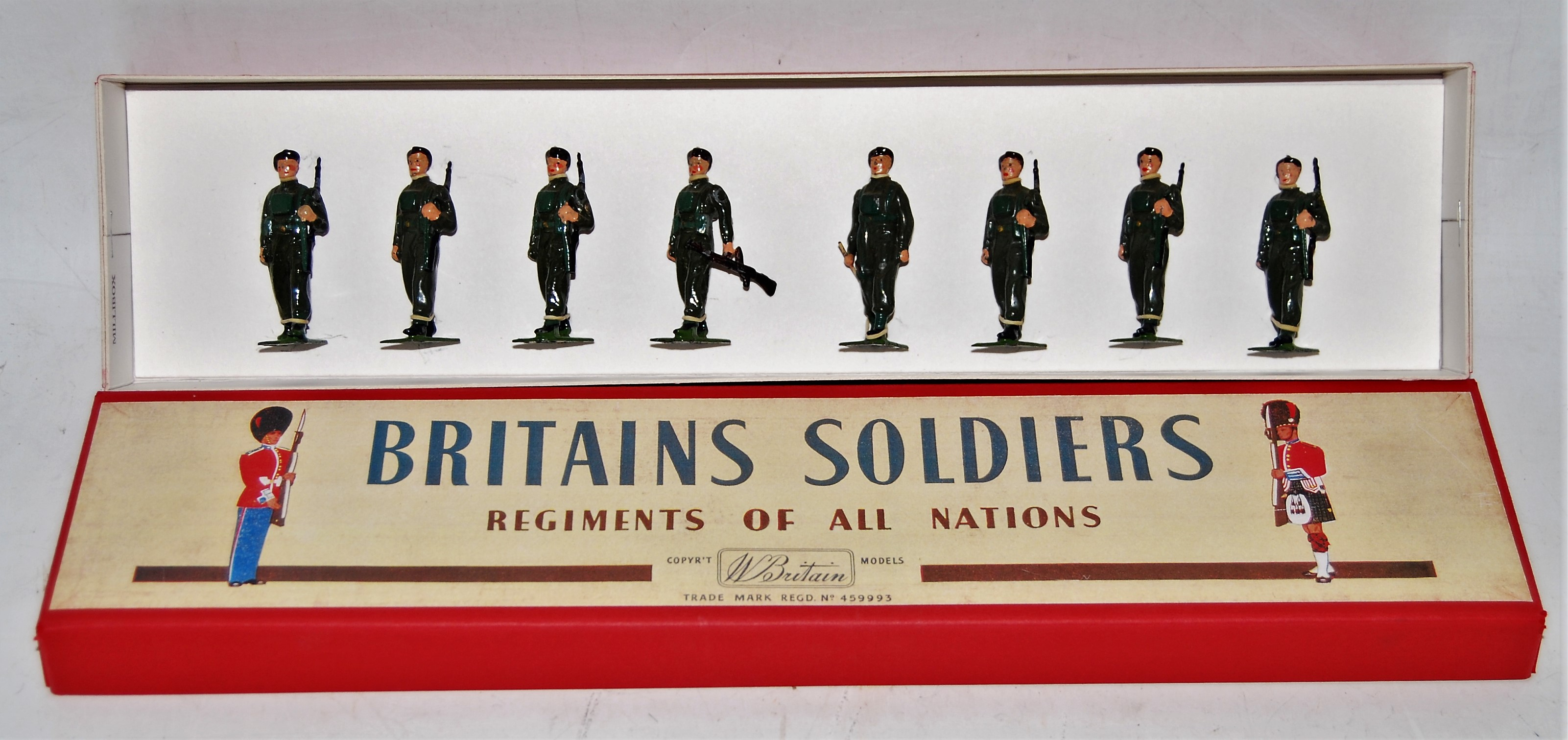 A Britains set No. 2010 Airborne Infantry comprising of officer with baton, marching soldier with