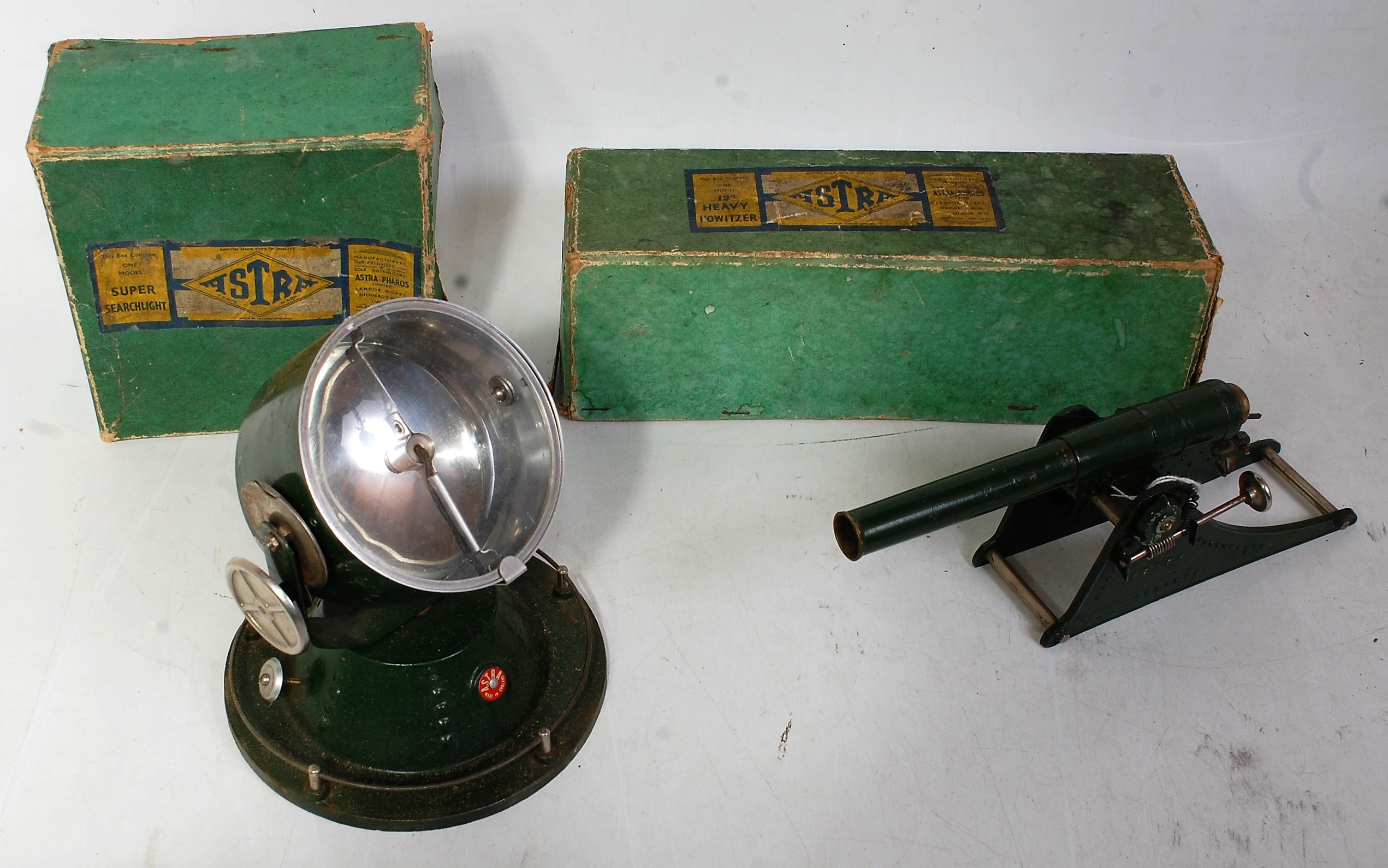 "An Astra Pharos boxed military implement group to include a boxed 12"" heavy howitzer, together"