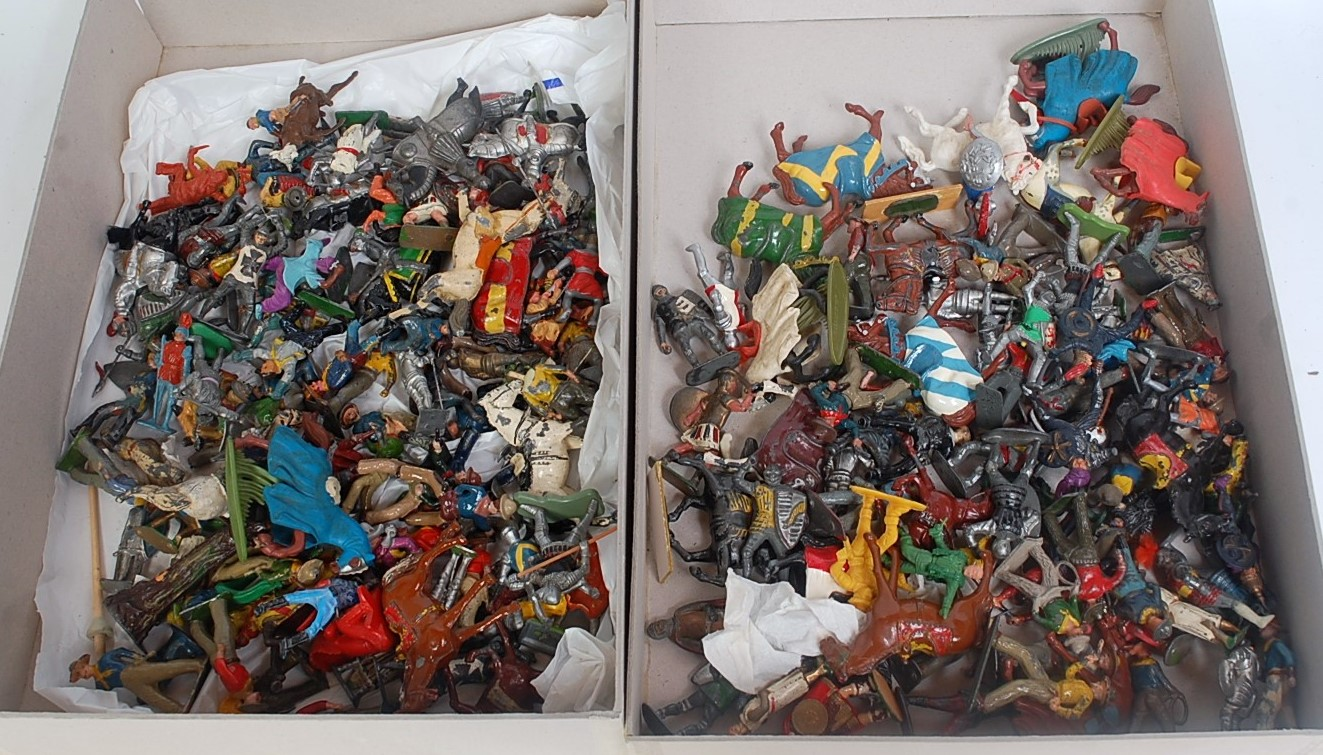 Two trays containing a quantity of various lead and plastic cowboys and medieval figures to