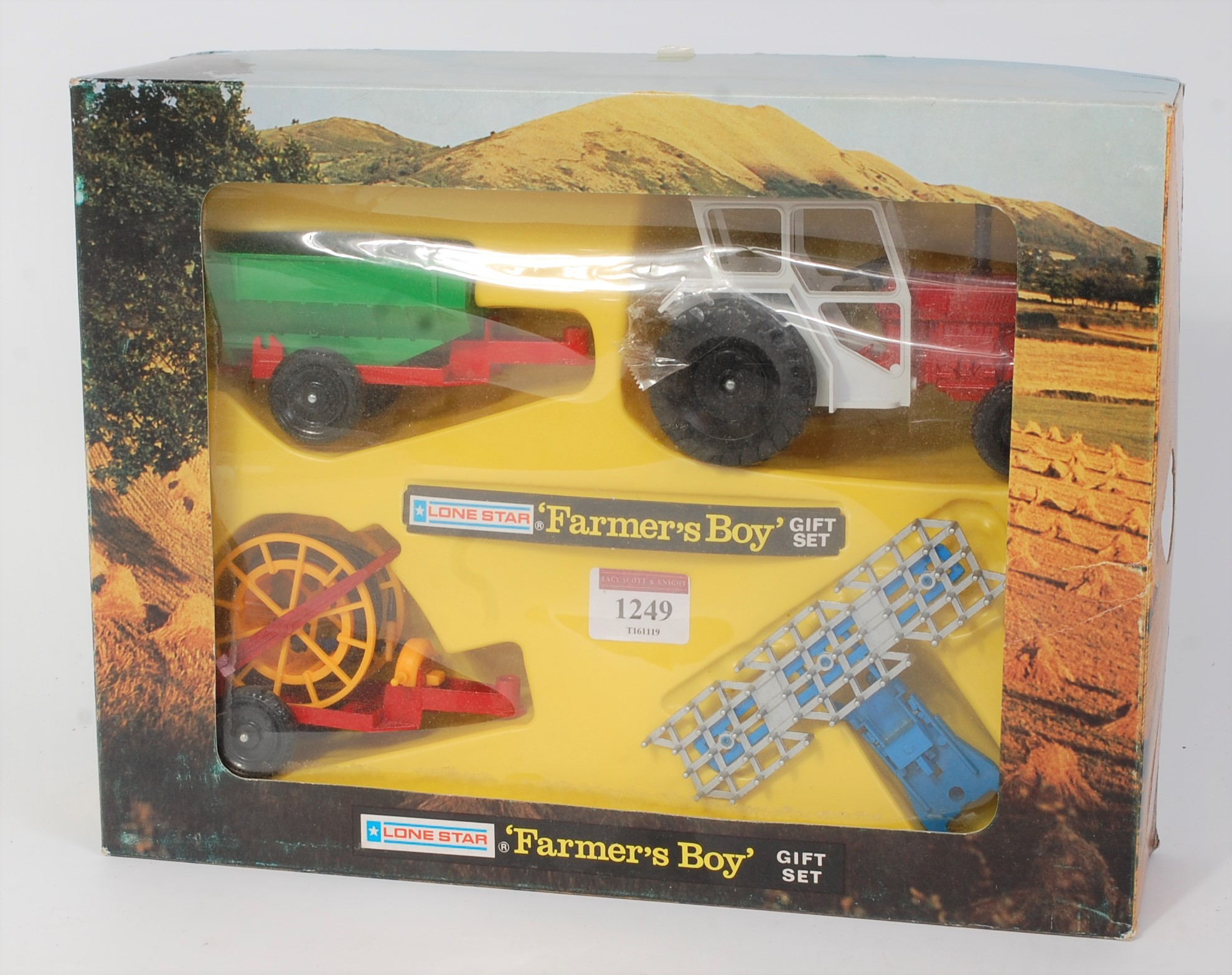 A Lonestar No. 1741 Farmers Boy gift set comprising of International Tractor with three various