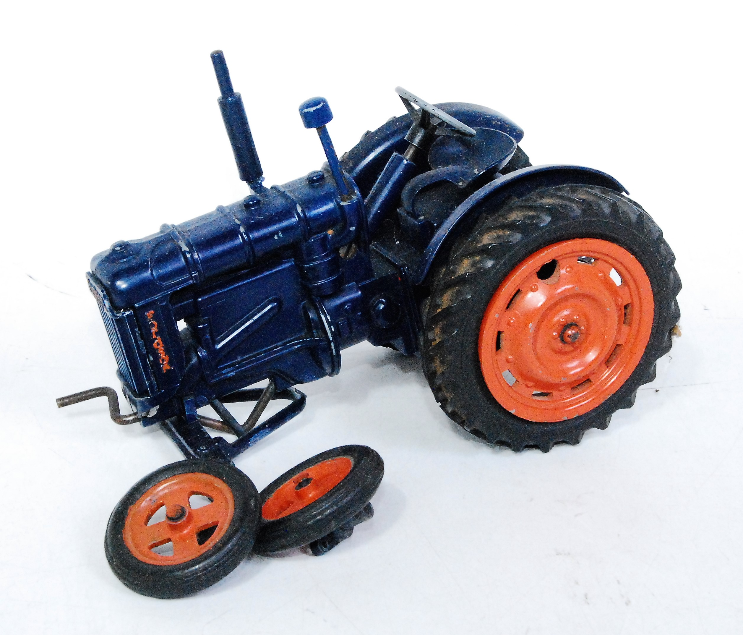 A Chad Valley No. 9235 clockwork model of a Fordson Major tractor, model requires restoration,