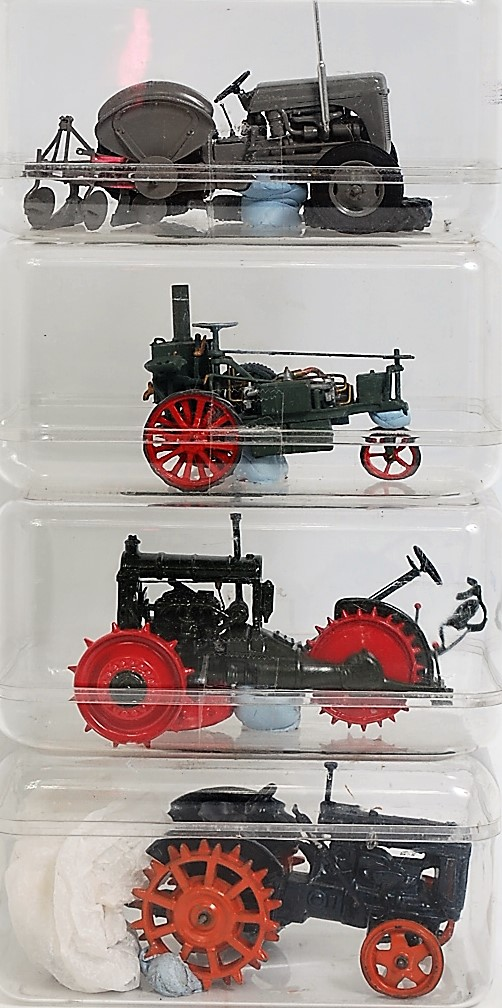 Four various diecast white metal and resin manufactured and handbuilt agricultural tractors, mixed