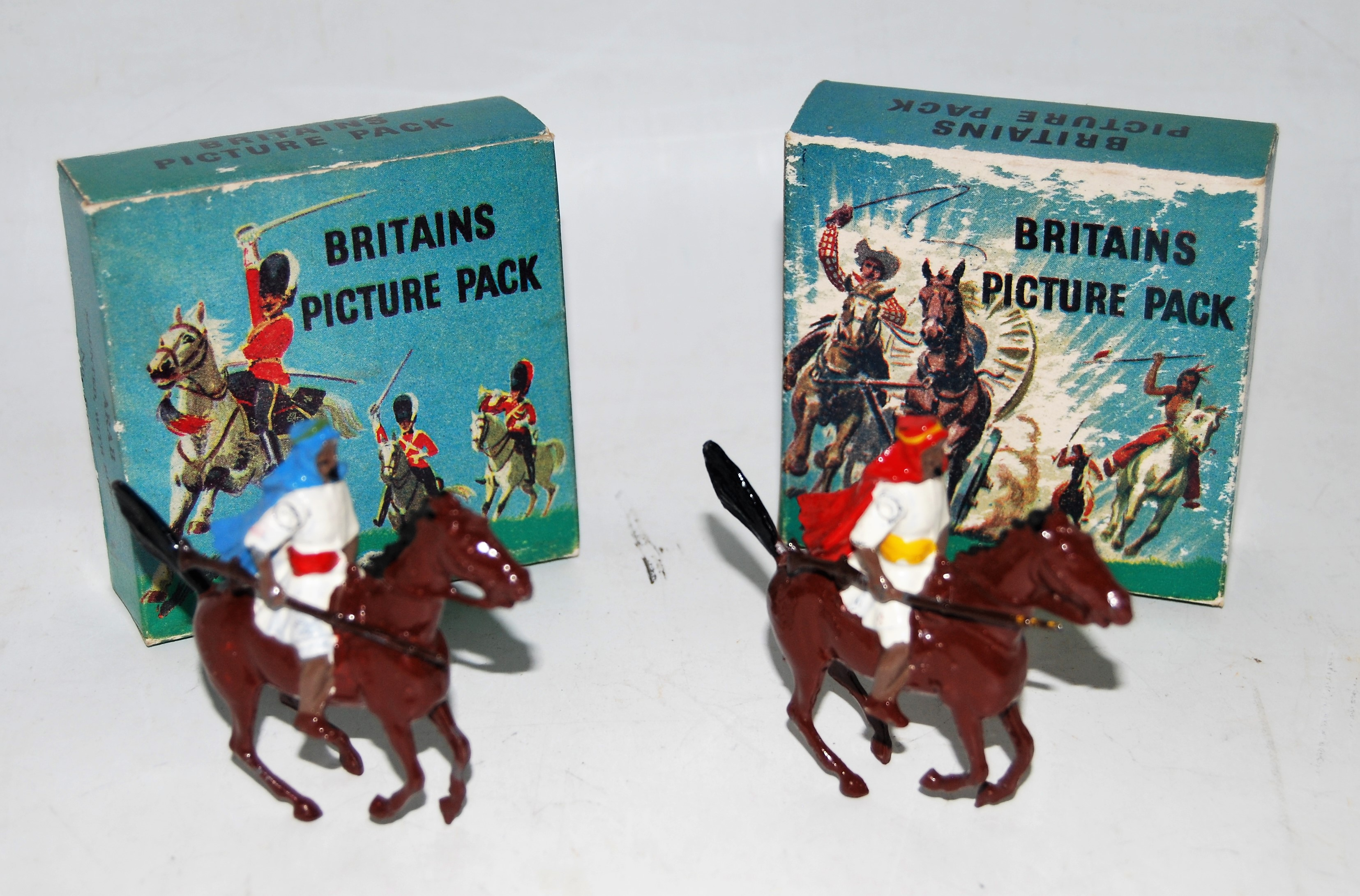 Two boxed Britains Picture pack series, No. 829B mounted Arabs with rifles, both housed in the