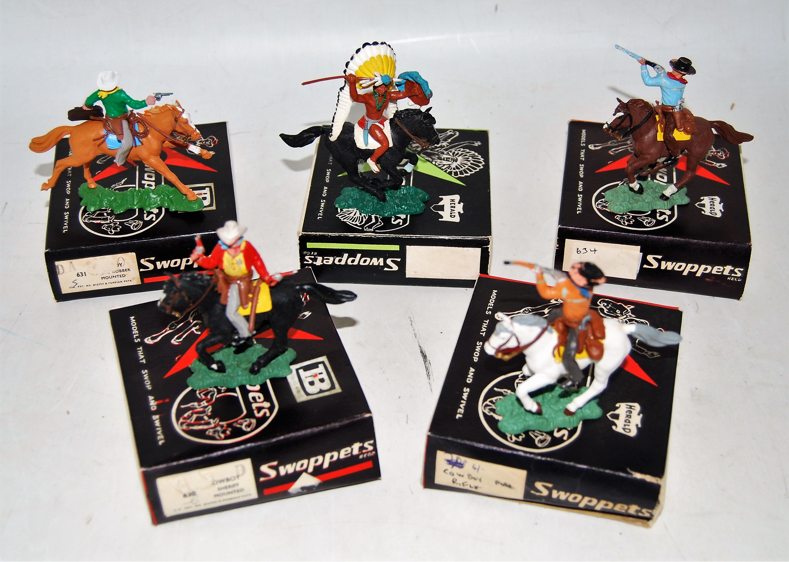 A Herald Swoppets boxed Cowboy & Indian plastic figure group to include Cowboy with rifle (mounted),