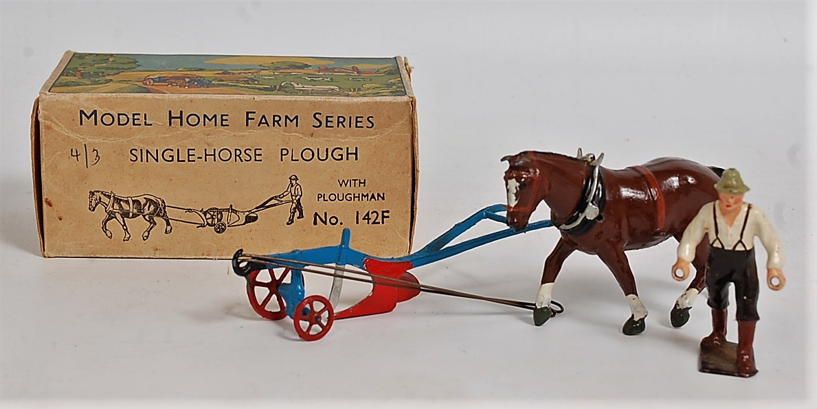 A Britains Farm Series No. 142F single horse plough, appears complete in the original duck-egg all-