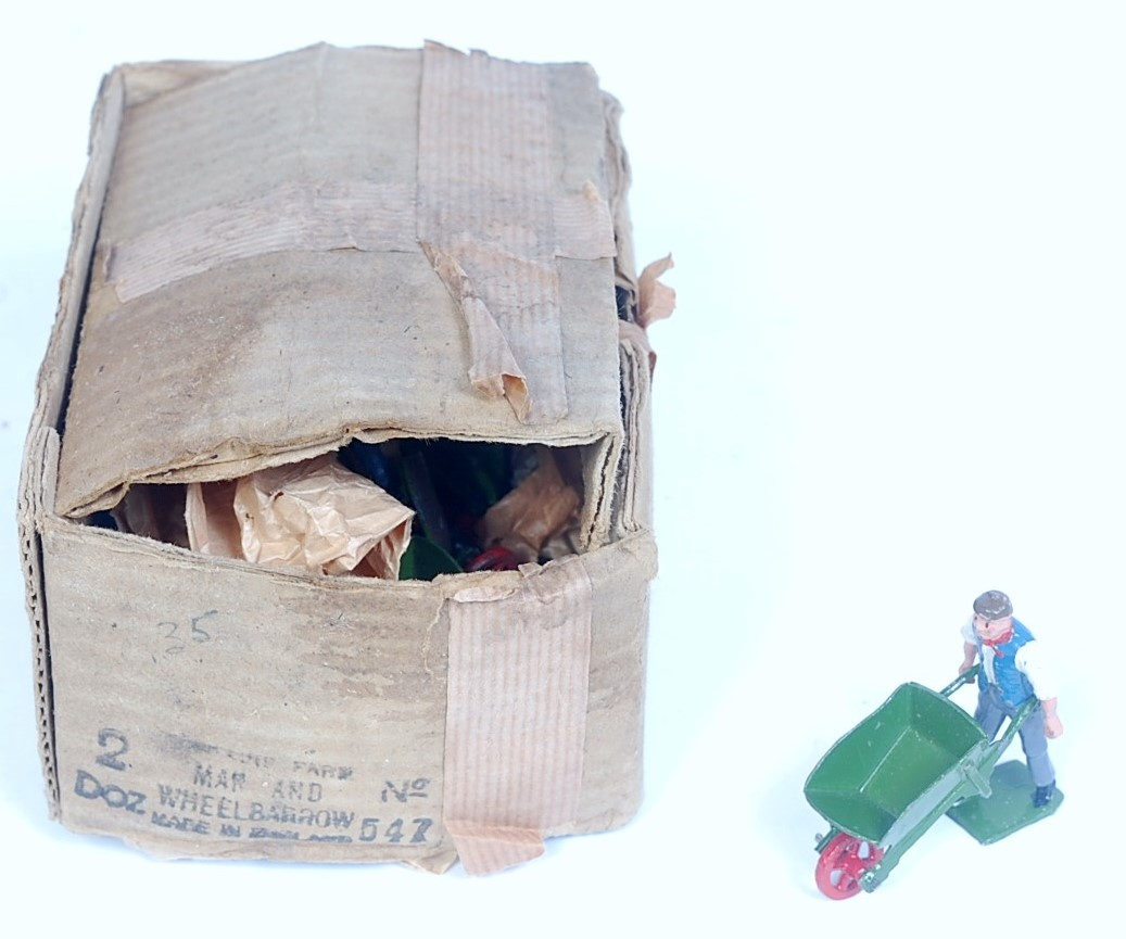 A Britains incomplete two dozen trade box of No. 547 Man with Wheelbarrow, 10+ examples, all