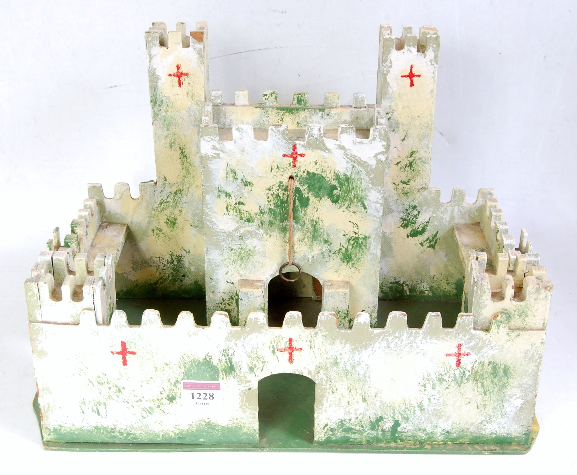A home-made scratch built wooden model of a medieval fort, hand painted with drawbridge, finished in