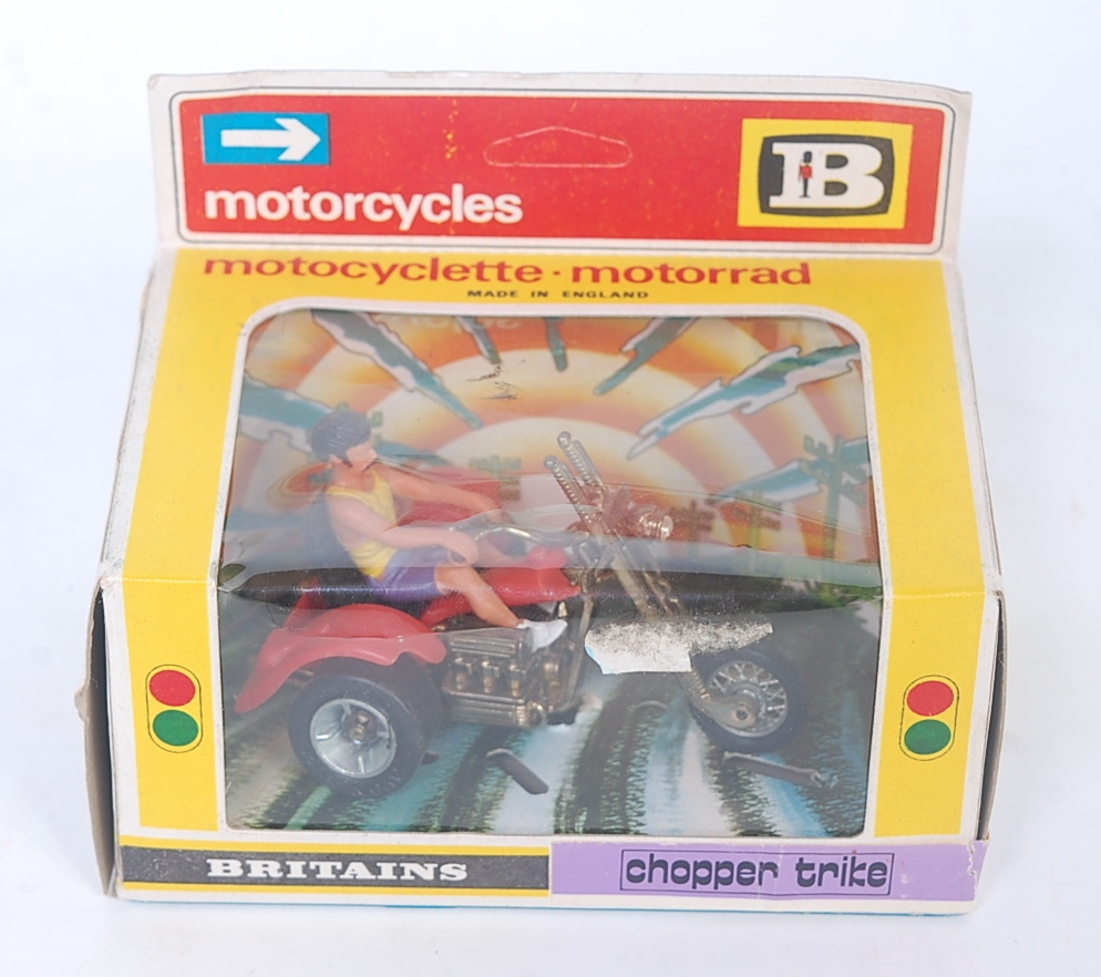 A Britains No. 9675 Chopper Trike comprising red and gold body with driver figure, in the original