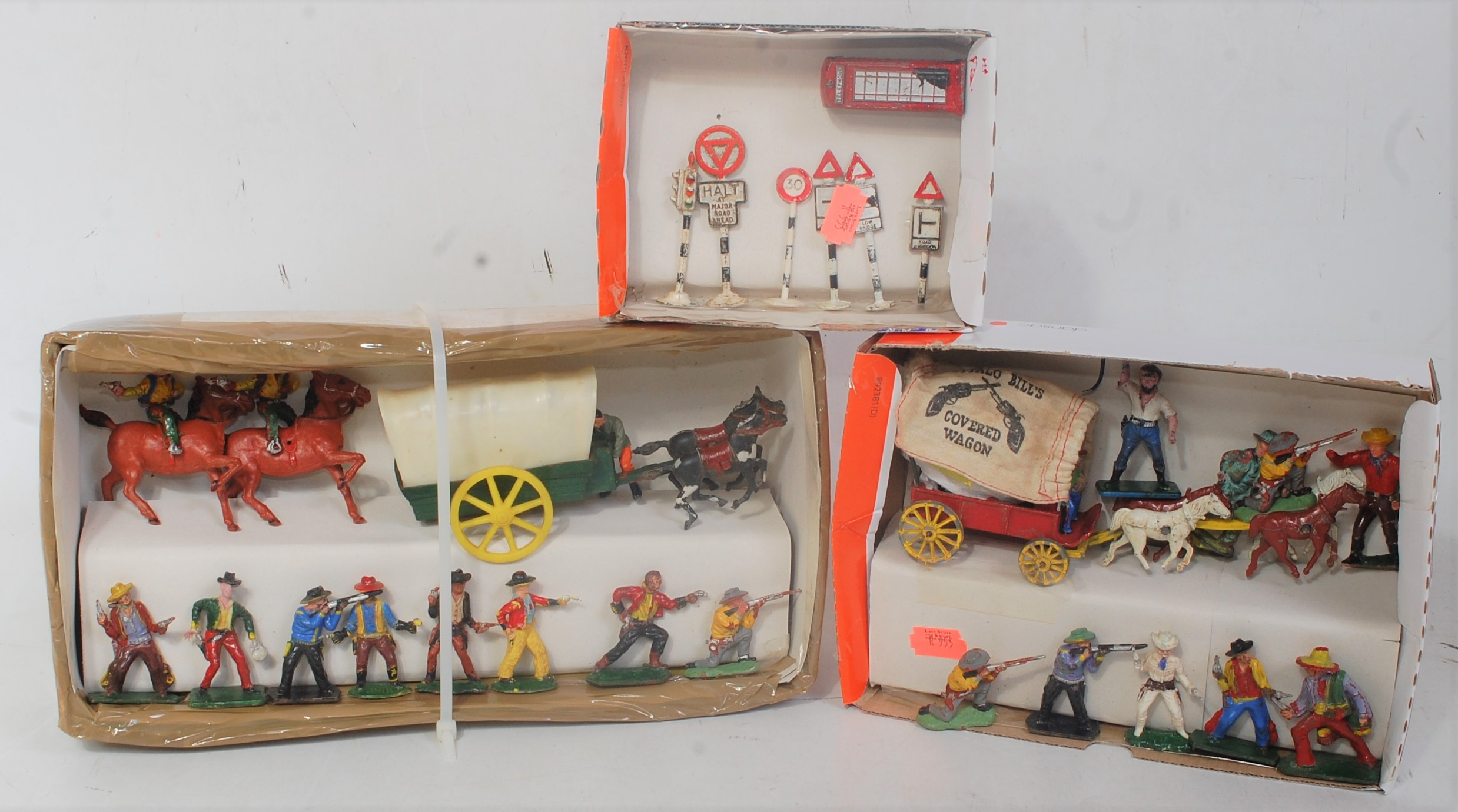 A collection of various loose plastic lead hollow cast and diecast cowboys and Indians roadside