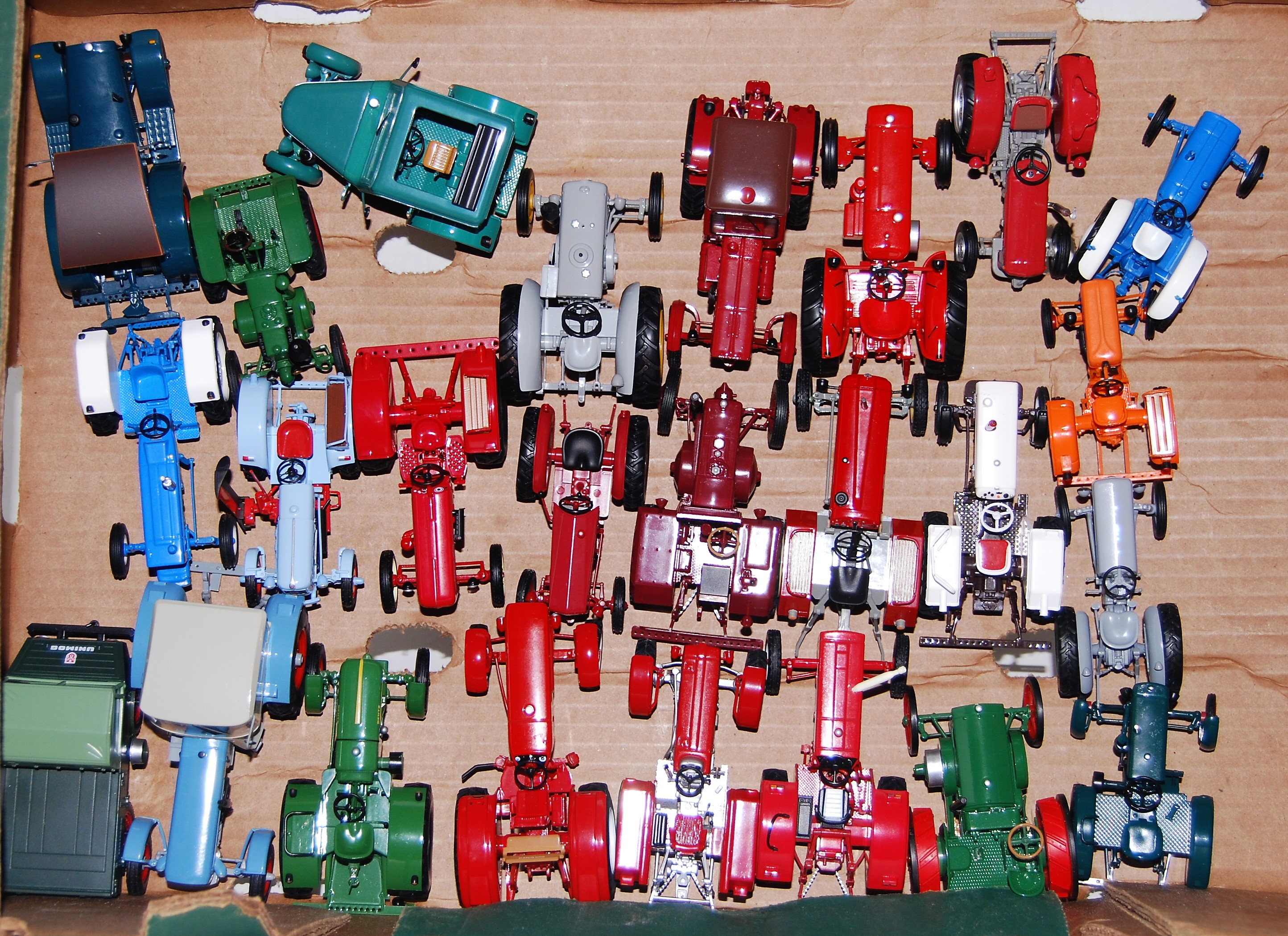 One tray containing a quantity of Atlas edition plastic and diecast model tractors to include a