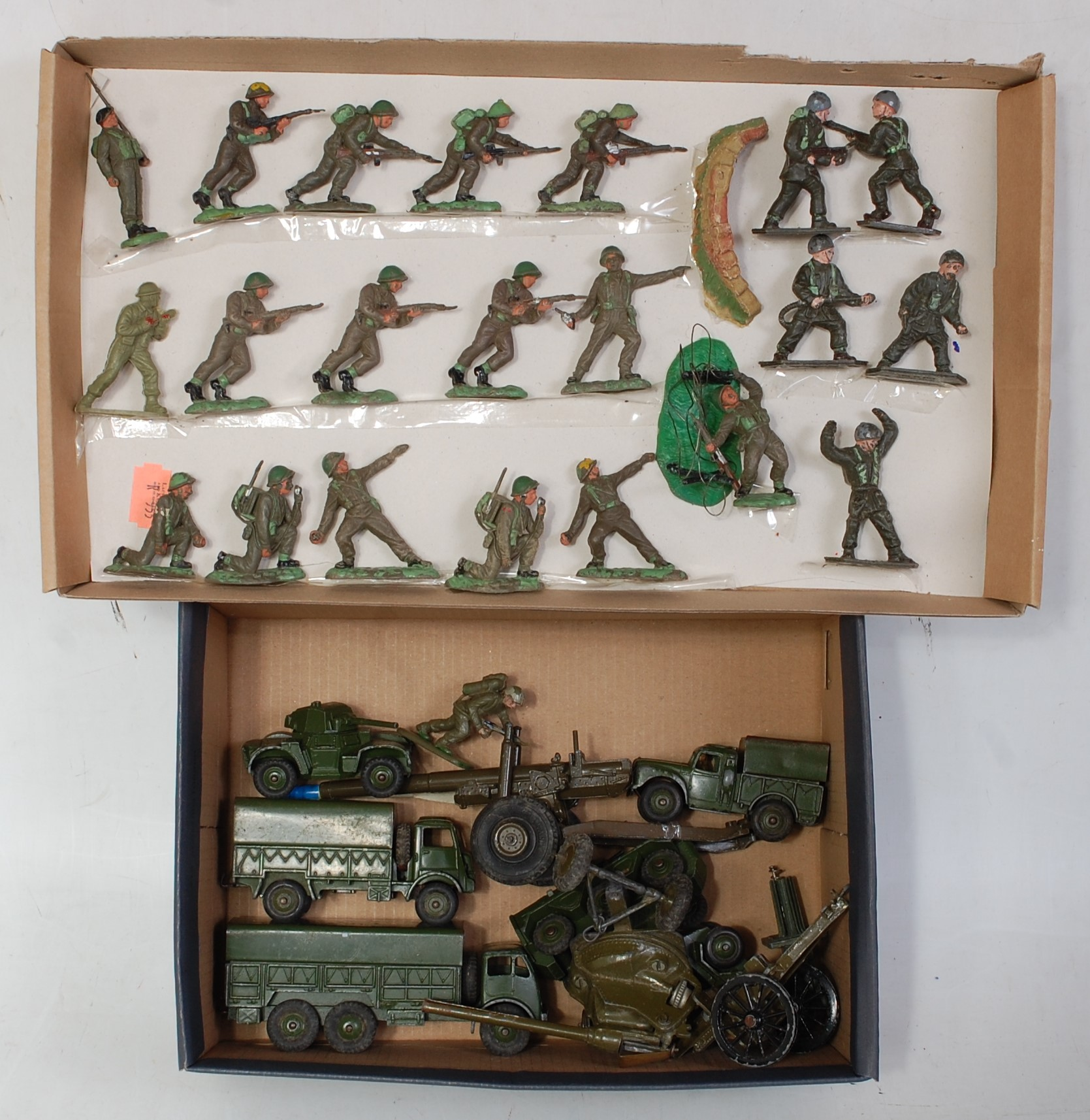 Two trays containing a mixed loose military diecast and plastic figures to include Dinky Toys,