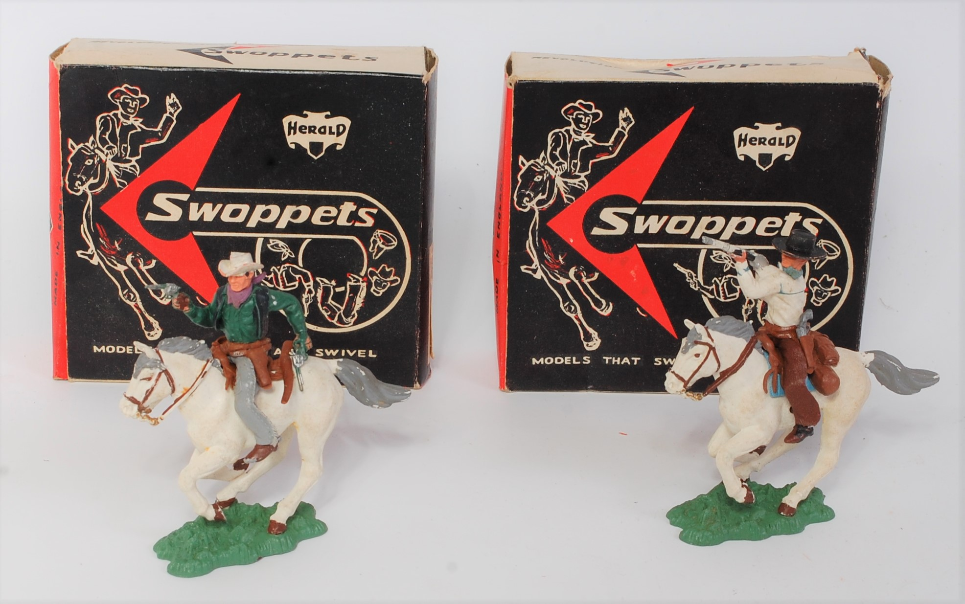 A Herald Swoppets mounted plastic cowboy action figure group, two boxed examples to include Ref.