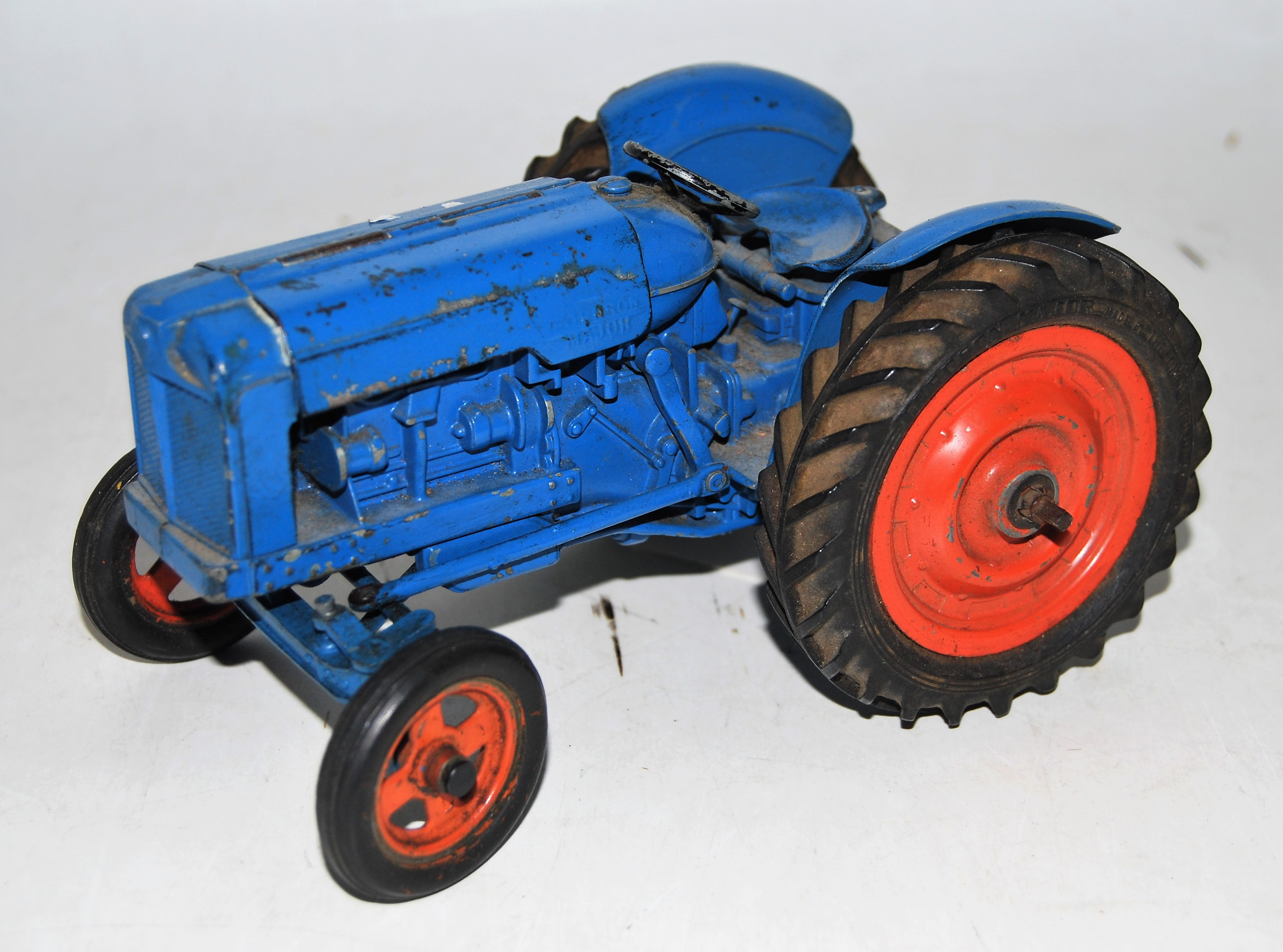A Chad Valley diecast and clockwork model of Fordson Major tractor comprising of blue body with