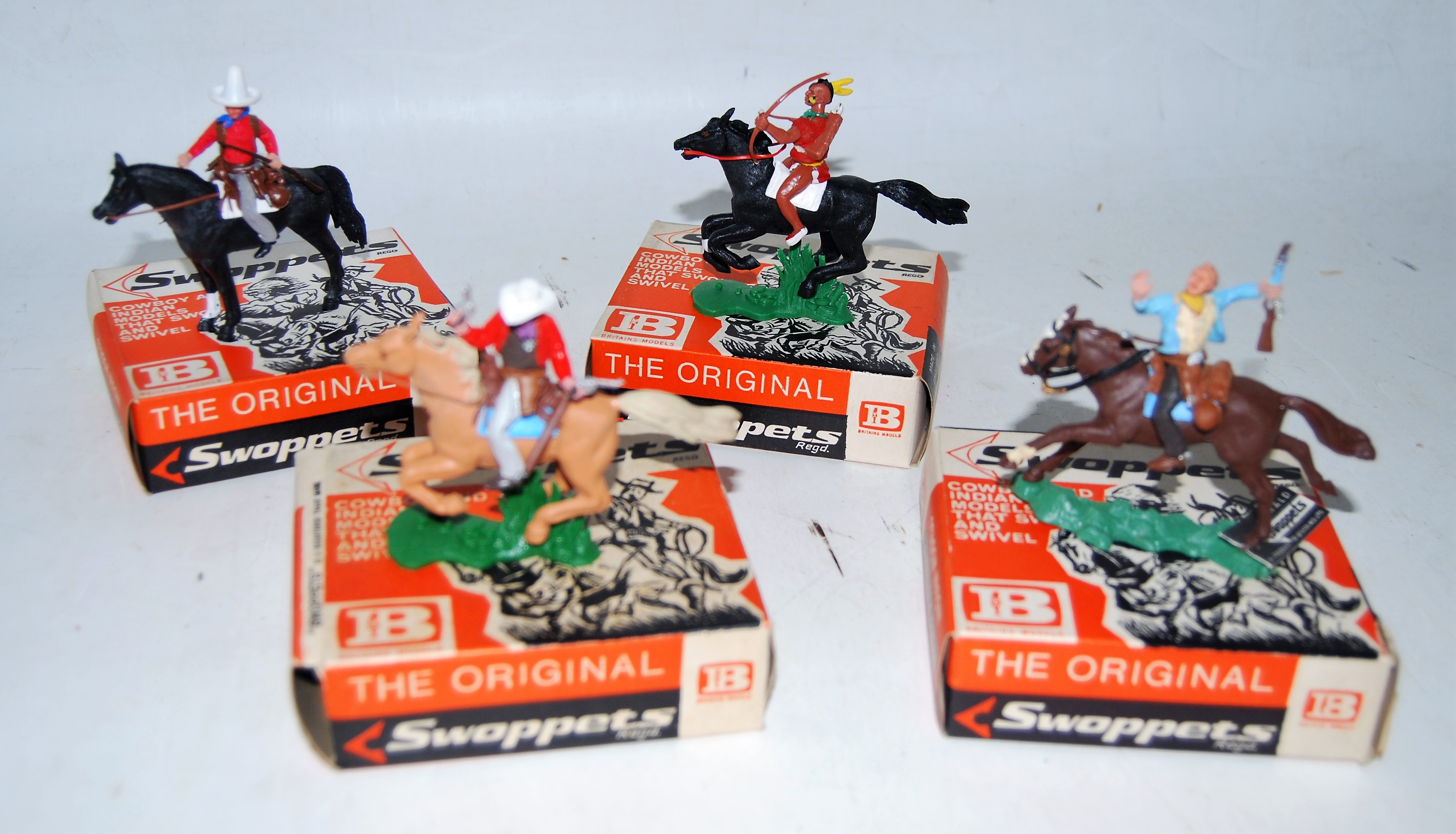 A Britains Swoppets boxed Cowboy & Indian plastic figure group to include No. 638 Cowboy resting (