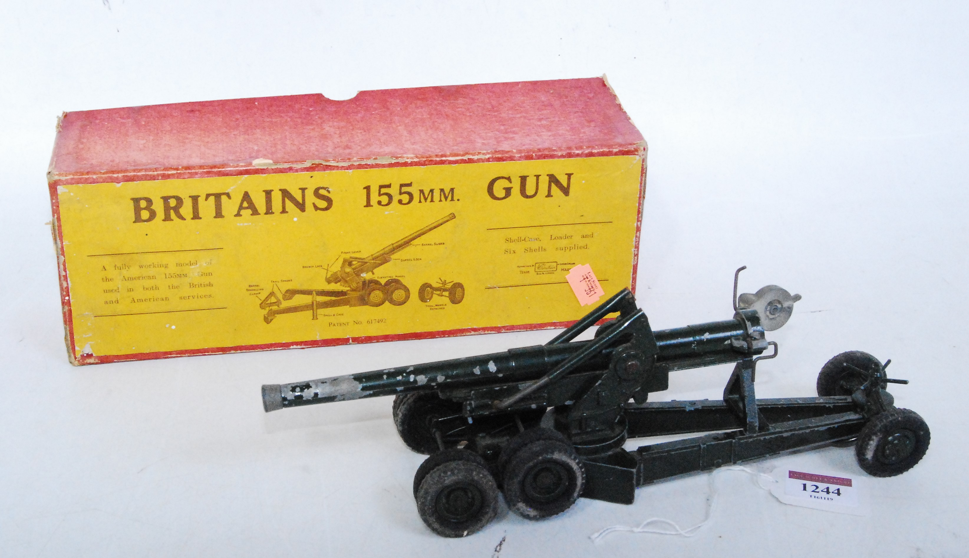 A Britains No. 2064 155mm field gun comprising of gun with shell case loader and six shells,