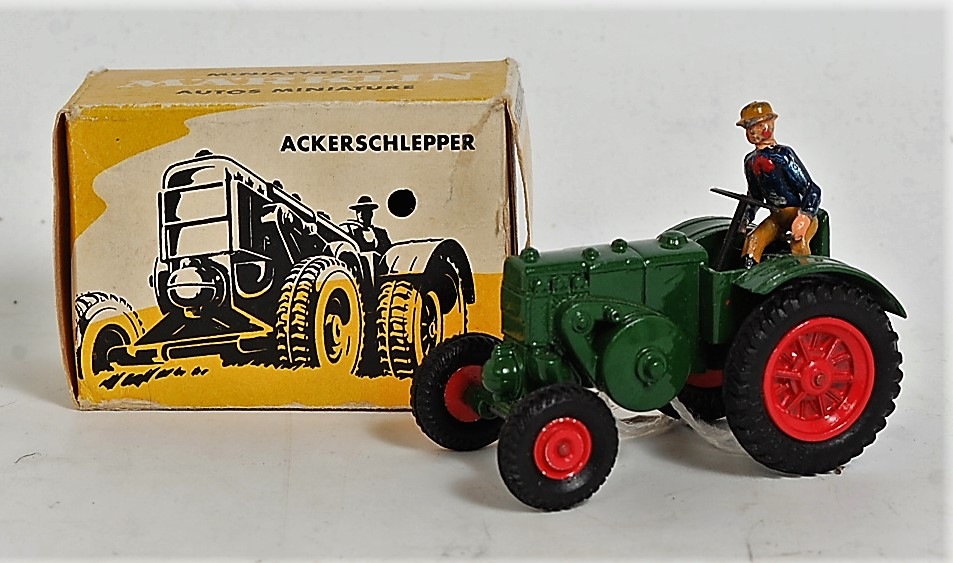 A Marklin No. 8029 Lanz agricultural tractor, finished in green with red hubs and driver figure