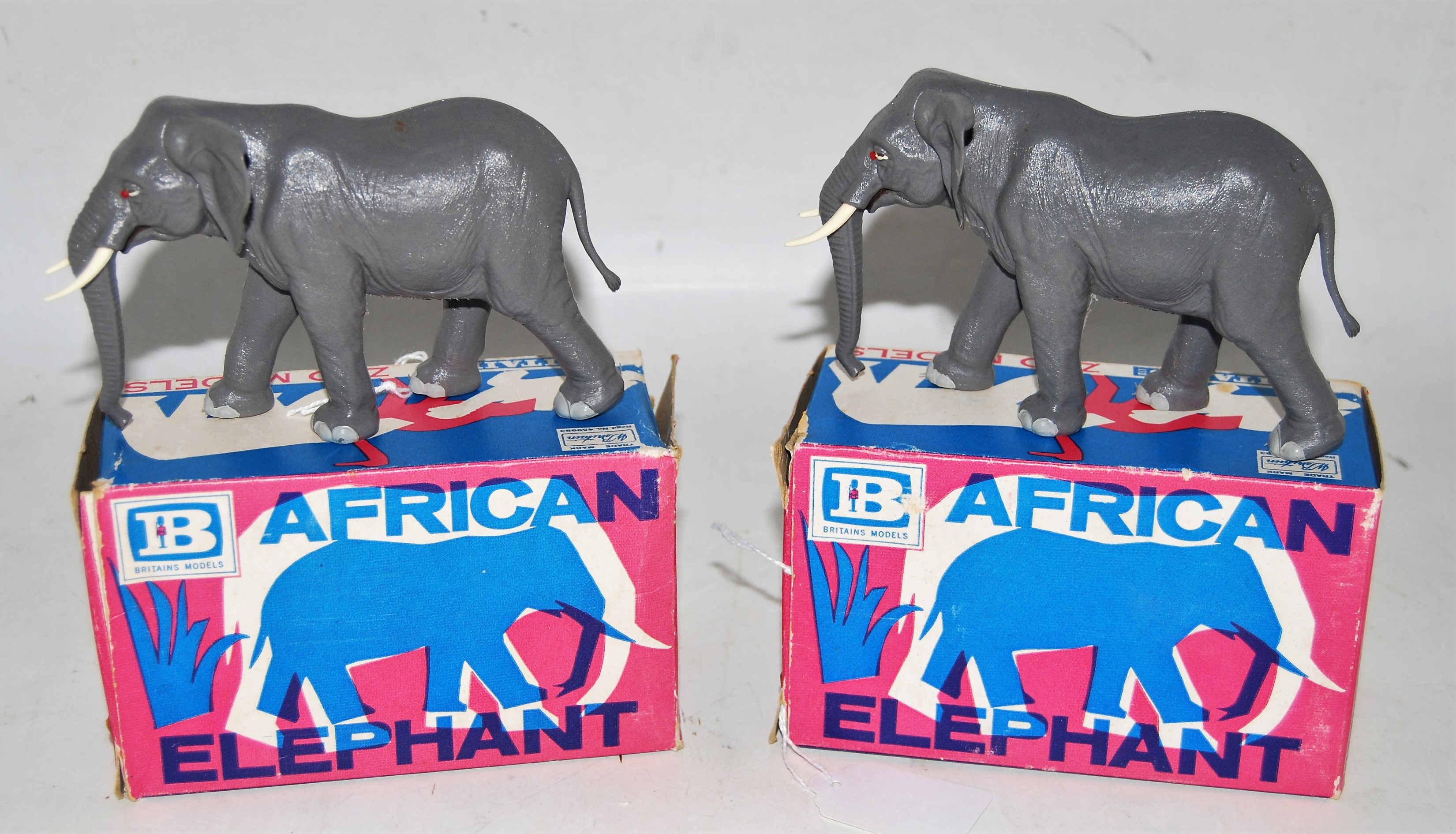 A Britains Zoo Models series plastic African elephant boxed group, two examples, both catalogue