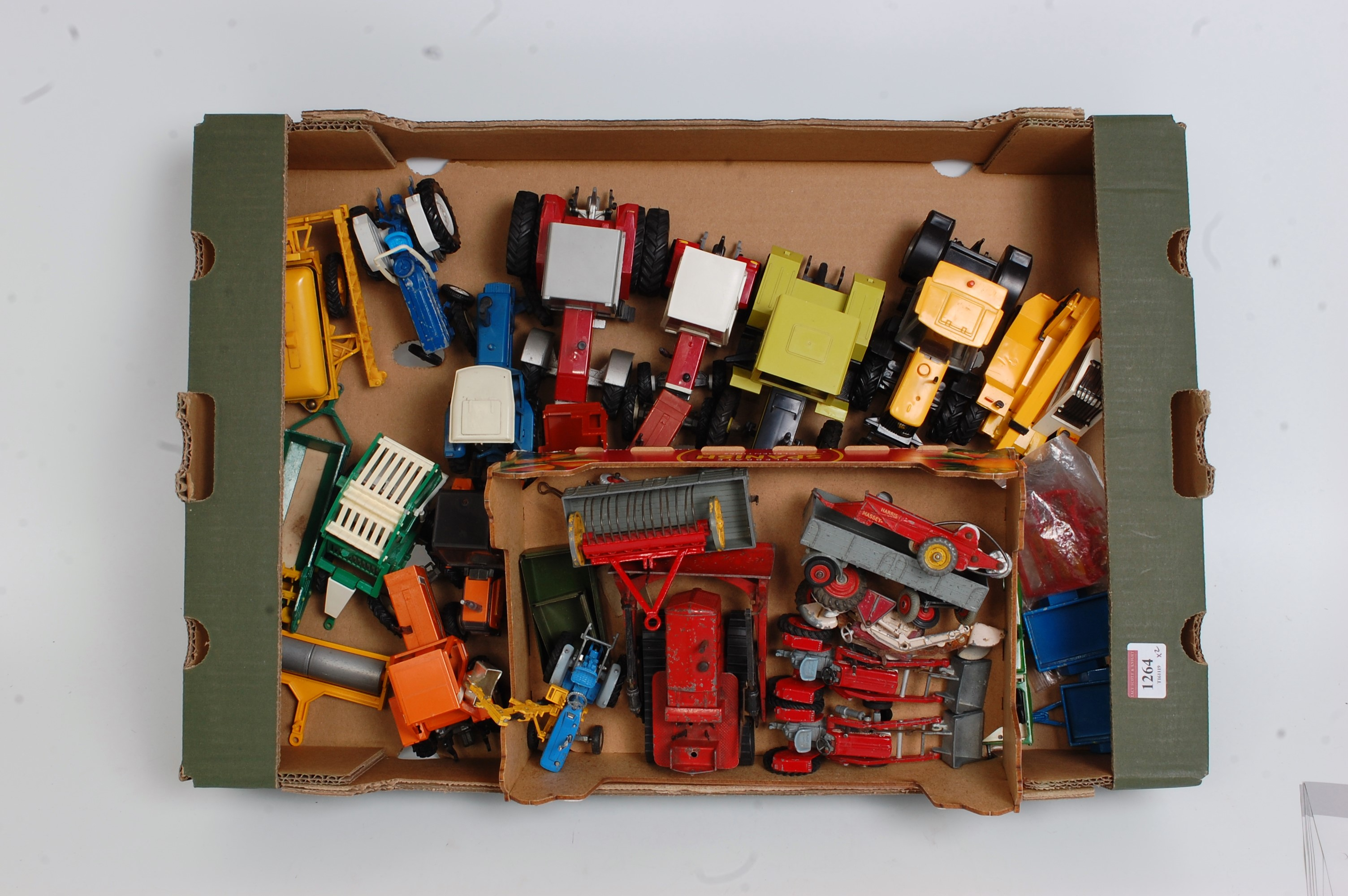 Two trays containing a quantity of various playworn Britains Dinky Toy and Corgi Toy diecasts, to