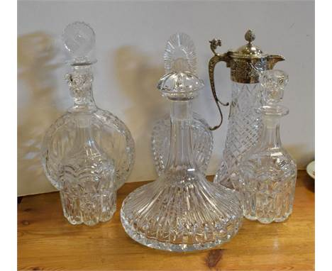 Royal Doulton cut glass ships decanter, four other decanters and a silver plated mounted carafe