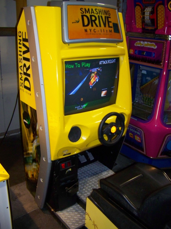 Lot 127 - SMASHING DRIVE NYC SITDOWN DRIVER ARCADE GAME