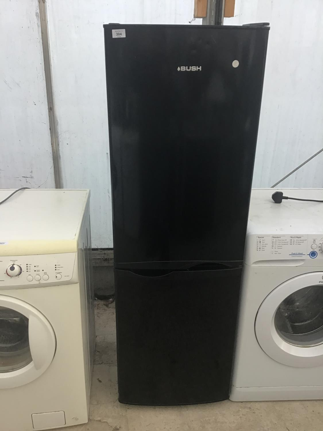 Lot 304 - A BLACK BUSH FRIDGE FREEZER IN WORKING ORDER WITH NEED OF MINOR CLEAN