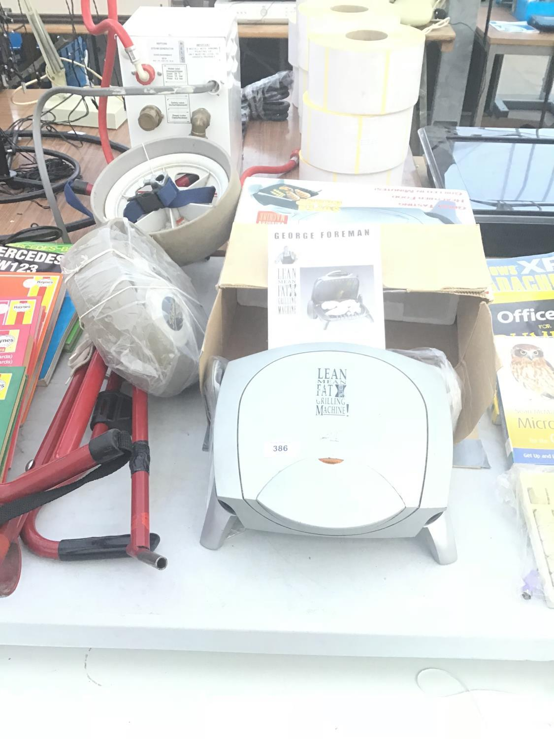 Lot 386 - A GEORGE FORMAN GRILL IN WORKING ORDER AND A GOLF TROLLEY (A/F)