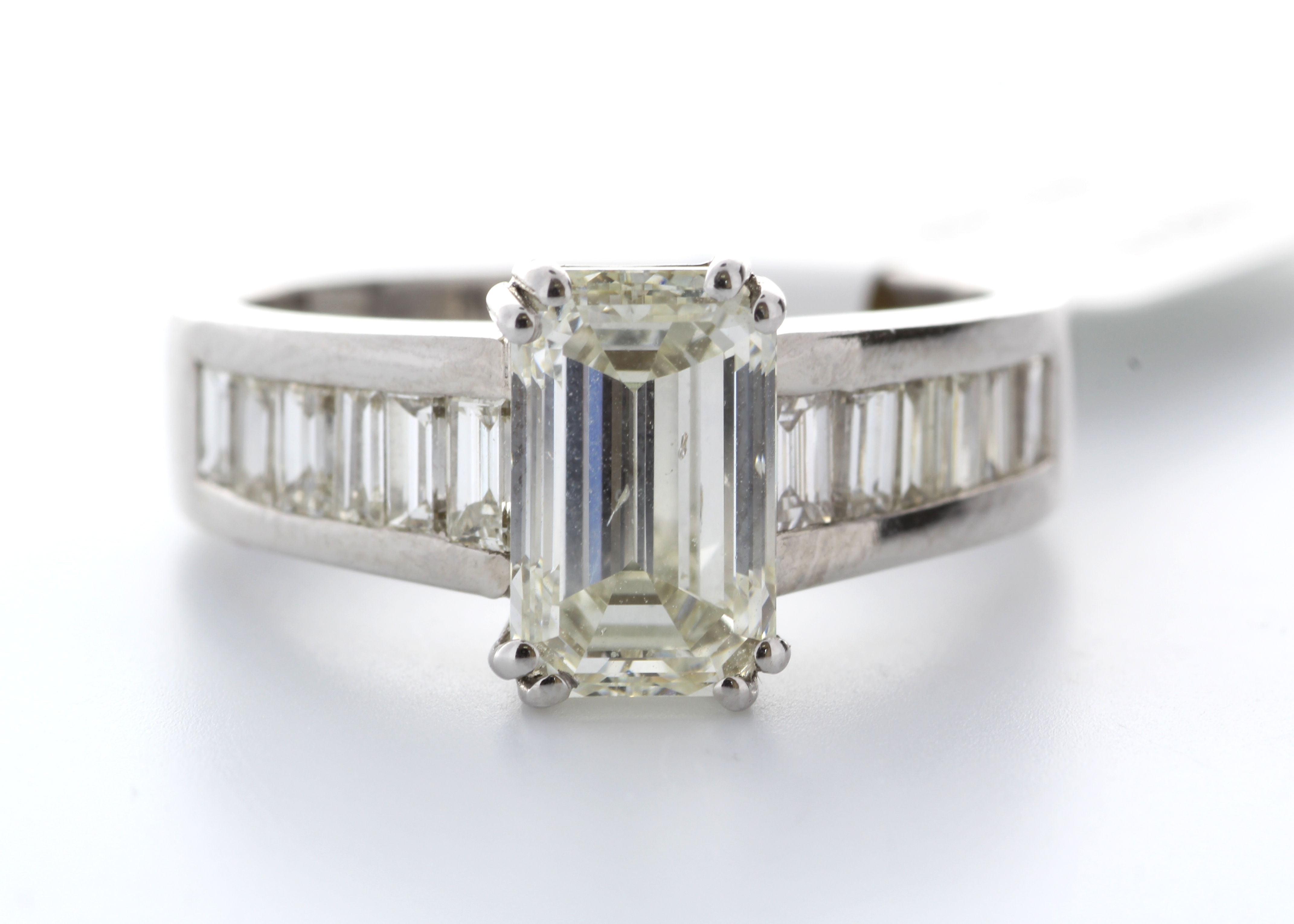 18k White Gold Single Stone Claw Set Emerald Cut With Stone Set Shoulders Diamond Ring (2.05) 2.90