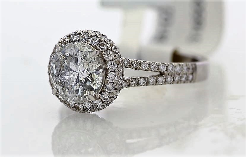 Lot 35 - 18k White Gold Single Stone With Halo Setting Ring 2.25