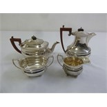 Lot 393 - Four piece silver teaset rounded rectangular with angled handles to include teapot, water jug, sugar