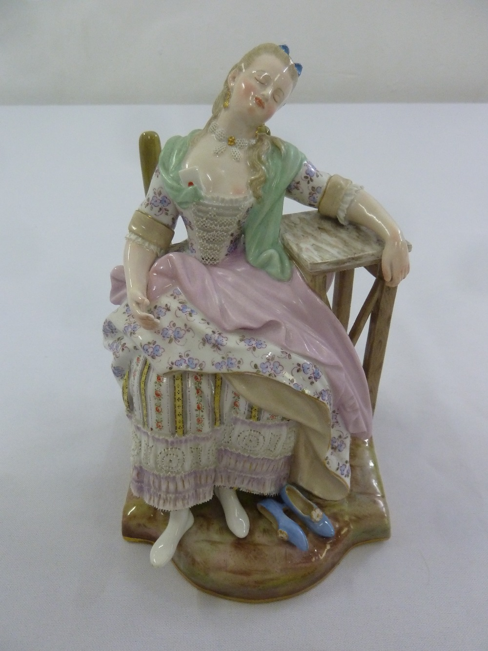 Lot 171 - Meissen 19th century figurine of a seated lady in 18th century attire, marks to the base, 18cm (h)