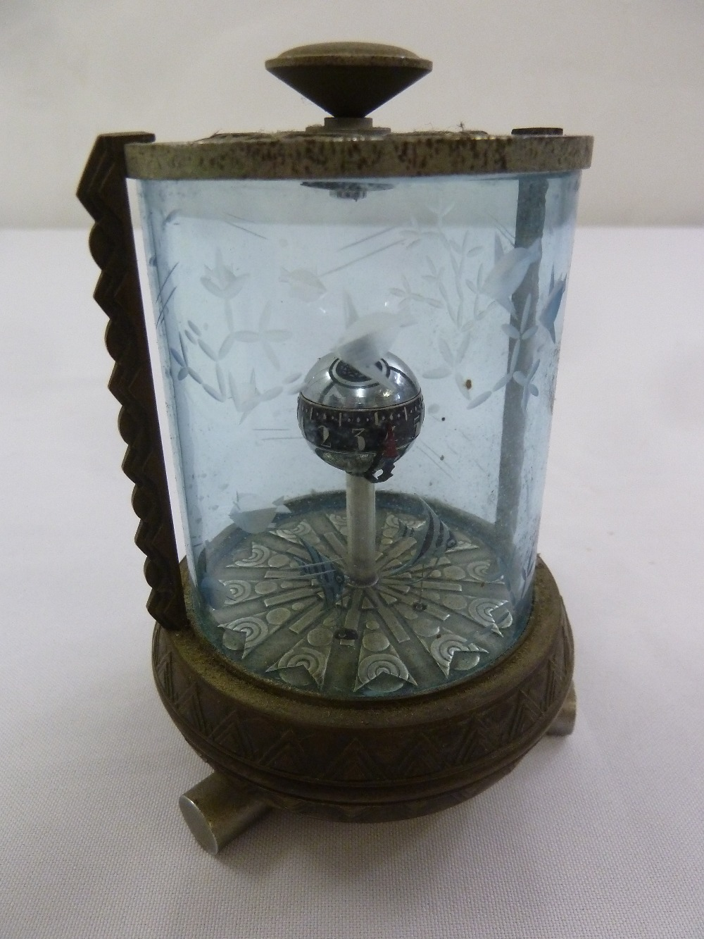 Lot 223 - An automaton desk clock in the form of an aquarium with etched glass and metal base and mounts