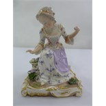 Lot 172 - Meissen figurine of a lady picking flowers, marks to the base, 17.5cm (h) A/F